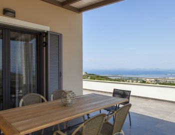 villa-melia-in-lefkada-greece-outside-seating-and-view-from-the-balcony