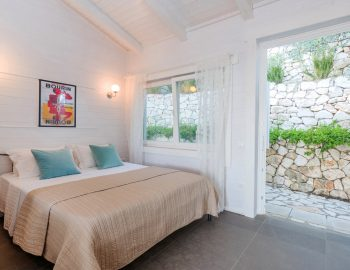 vasiliki-cottages-villa-afteli-accommodation-for-couples-and-adults-only-double-bedroom-with-garden-view