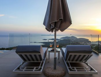 villa-achilles-sunset-sivota-epirus-greece-sunbeds-umbrella-with-sunset-view.jpg
