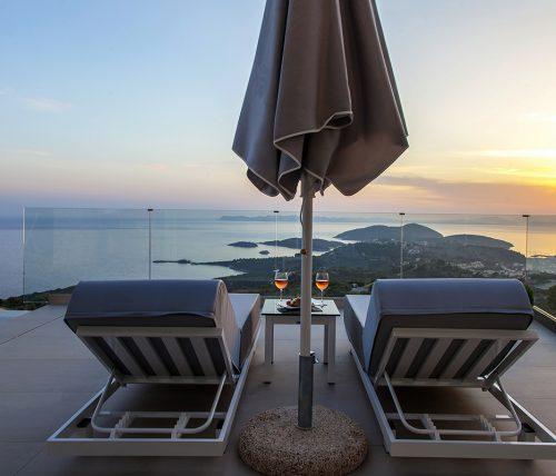 villa-achilles-sunset-sivota-epirus-greece-sunbeds-umbrella-with-sunset-view