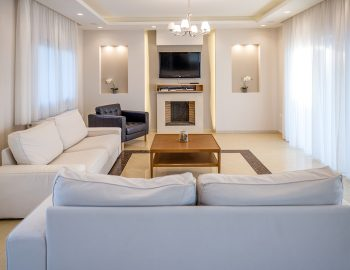 villa-agios-ioannis-lefkada-greece-accommodation-lounge-room-with-fire-place-and-smart-tv.jpg