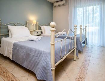 villa-agios-ioannis-lefkada-greece-accommodation-twin-bedroom-with-outdoor-access.jpg