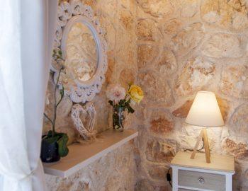 villa-alexandros-tsoukalades-lefkada-greece-bedroom-stone-feature