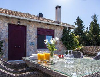 villa-alexandros-tsoukalades-lefkada-greece-dining-area-with-mountain-views