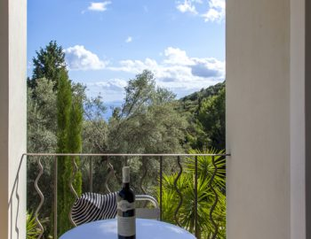 villa-amadeus-poros-lefkada-greece-master-bedroom-private-balcony-with-sea-view