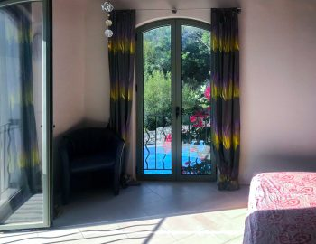 villa-amadeus-poros-lefkada-greece-upstairs-double-bedroom-with-pool-view