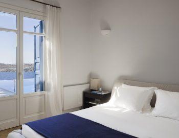 villa-amvrosia-agios-lazaros-mykonos-greece-double-bedroom-with-pool-view