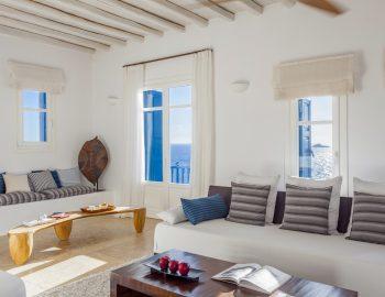 villa-amvrosia-agios-lazaros-mykonos-greece-open-living-area-with-traditional-seating