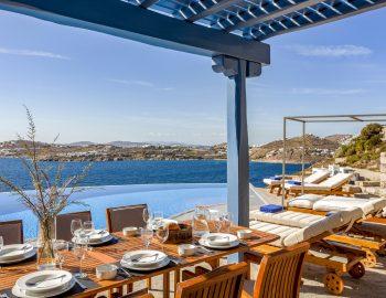 villa-amvrosia-agios-lazaros-mykonos-greece-outdoor-dining-with-pool-and-sea-view