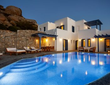 villa-amvrosia-agios-lazaros-mykonos-greece-private-pool-area-during-the-evening