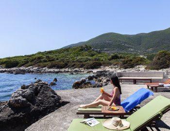 villa-anemus-sivota-lefkada-greece-girl-by-the-sea