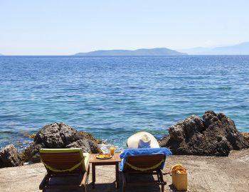 villa-anemus-sivota-lefkada-greece-girl-on-sunbed-by-the-sea