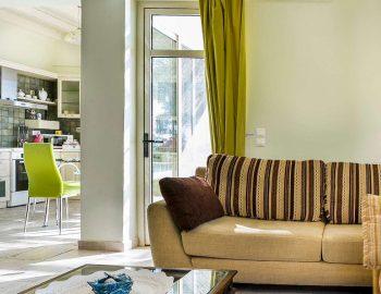 villa-anemus-sivota-lefkada-greece-lounge-with-kitchen-view