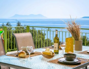 villa-anemus-sivota-lefkada-greece-outdoor-dining-with-sea-view