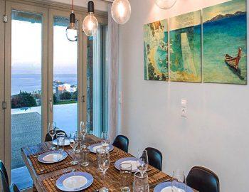 villa-assa-mykonos-greece-cyclades-islands-indoor-dining-area-with-sea-view