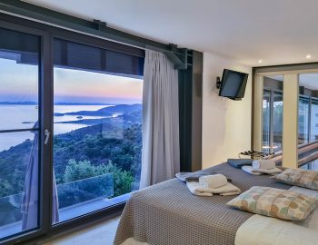 villa blue infinity syvota epirus greece upper bedroom with sunset