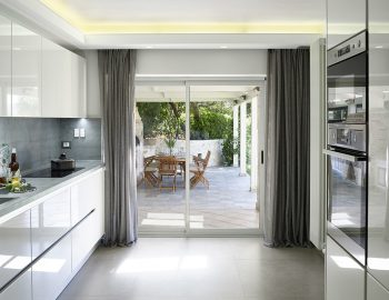 villa-christina-sivota-epirus-greece-kitchen-with-outdoor-dining-access.jpg