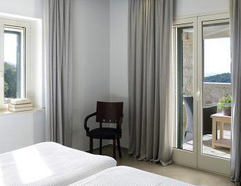 villa-christina-sivota-epirus-greece-twin-bedroom-with-private-balcony.jpg