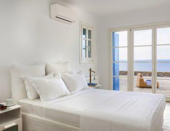 villa-dafni-agios-lazaros-mykonos-greece-double-bedroom-with-outdoor-access-and-sea-view