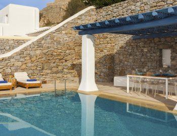 villa-dafni-agios-lazaros-mykonos-greece-sun-loungers-and-dining-areas-by-the-pool