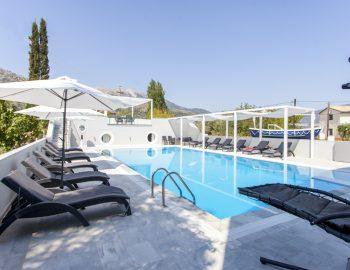 villa-ferry-boat-geni-lefkada-greece-deck-chairs-patio-pool