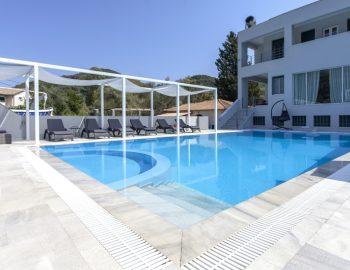 villa-ferry-boat-geni-lefkada-greece-exterior-private-pool-patio-deck-chairs