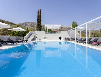 villa-ferry-boat-geni-lefkada-greece-pool-privacy-blue-deck-chairs