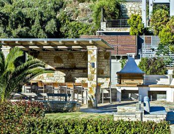 villa-giulia-karvouno-beach-sivota-epirus-greece-outdoor-bbq-area-with-garden-and-seating