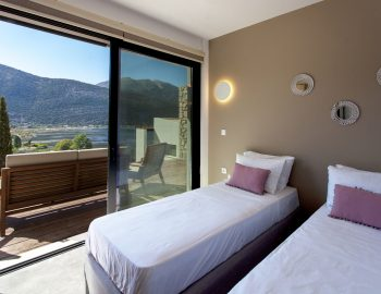 villa-idanos-dessimi-lefkada-greece-lower-level-twin-bedroom-with-outdoor-deack-area-access