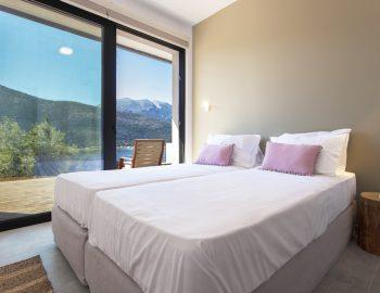 villa-idanos-dessimi-lefkada-greece-lower-level-twin-bedroom-with-sea-view