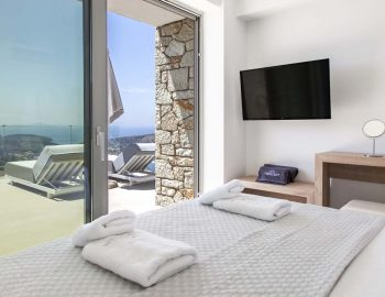 villa-ioulia-cave-style-sivota-thesprotias-view-bedroom-double-bed-tv