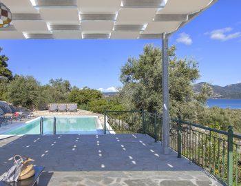 villa-loulou-nikiana-lefkada-greece-outdoor-lounge-area-with-pool-and-sea-view