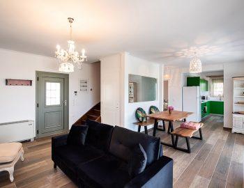 villa-loulou-nikiana-lefkada-open-plan-living-room-dining-area-sofa