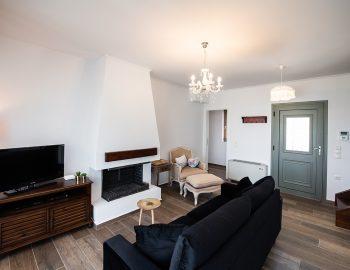 villa-loulou-nikiana-lefkada-open-plan-living-room-fireplace