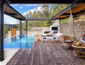 villa-luca-desimi-lefkada-greece-girl-in-outdoor-private-pool-area