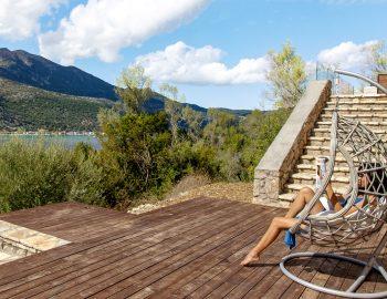villa-luca-desimi-lefkada-greece-girl-on-swinging-chair-feature