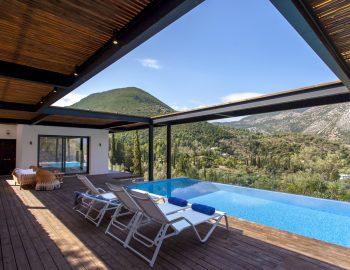 villa-luca-dessimi-lefkada-greece-deck-area-with-mountain-view