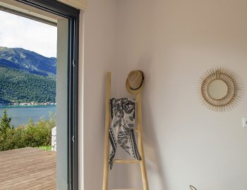 villa-luca-geni-desimi-lefkada-greece-lower-ground-bedroom-with-view-of-deck-and-vlicho-bay
