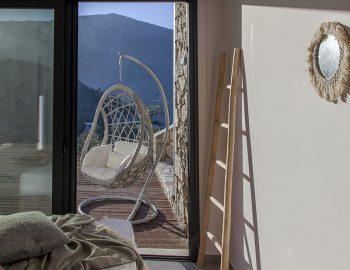 villa-luca-geni-desimi-lefkada-greece-lower-level-double-bedroom-with-swinging-chair-feature