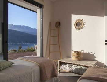 villa-luca-geni-desimi-lefkada-greece-lower-level-twin-bedroom-during-sunset