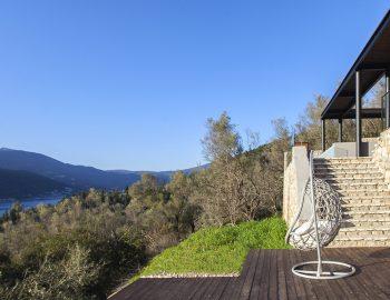 villa-luca-geni-desimi-lefkada-greece-swinging-chair-feature-with-view-of-vlicho-bay