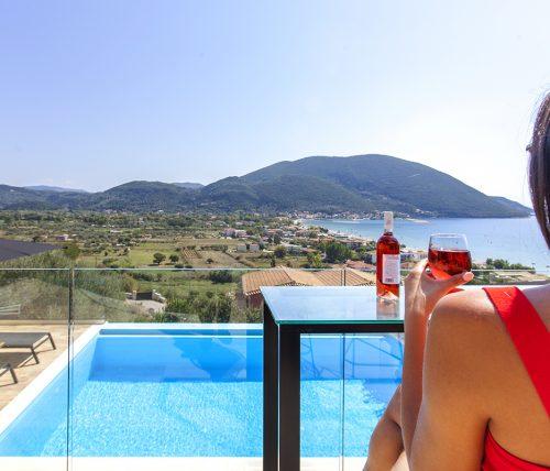 villa-maria-vasiliki-lefkada-lefkas-accommodation-girl-having-wine-pool-view