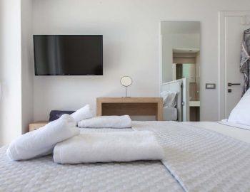villa-michaela-cave-style-sivota-thesprotias-double-bed-bedroom-tv-multimedia