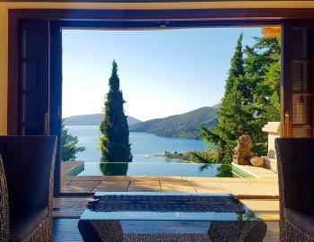 villa-mimoza-nidri-lefkada-luxury-accommodation-greece-master-bedroom-living-room-with-pool-view