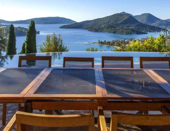 villa-mimoza-nidri-lefkada-luxury-accommodation-greece-outdoor-dining-table-with-ionian-sea-view