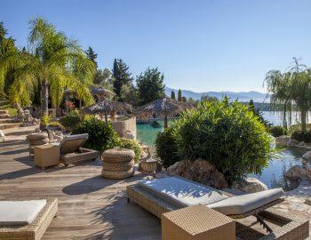 villa-mimoza-nidri-lefkada-luxury-accommodation-greece-sunbed-area-with-pool-view