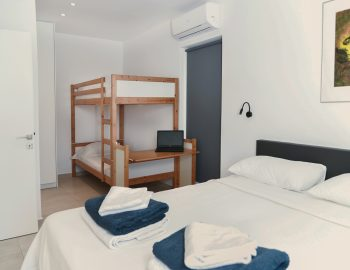 villa-mouria-paleros-greece-double-bedroom-with-bunk-beds