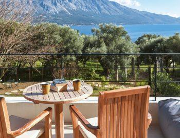 villa-mouria-paleros-greece-outdoor-table-with-garden-and-sea-views