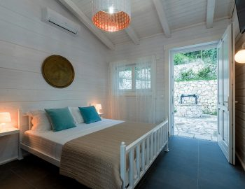 villa-mylos-vasiliki-cottages-lefkada-greece-adults-only-accommodation-double-bedroom-with-garden-view