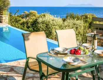 villa-ostria-sivota-lefkada-greece-dining-by-the-pool
